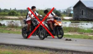 anak sekolah naik motor